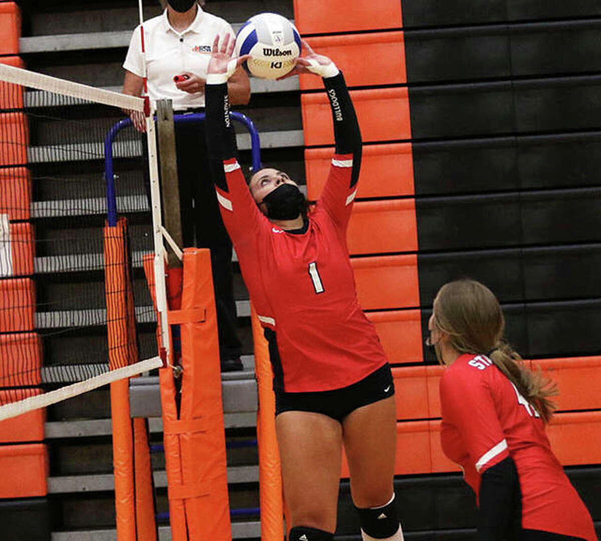 Staunton's Savannah Billings (1), shown setting while teammate Kennedy Legendre goes to the net in a match at the Edwardsville Tourney on Sept. 3, had 21 assists in the Bulldogs' two-set win over Auburn on Tuesday in Staunton.