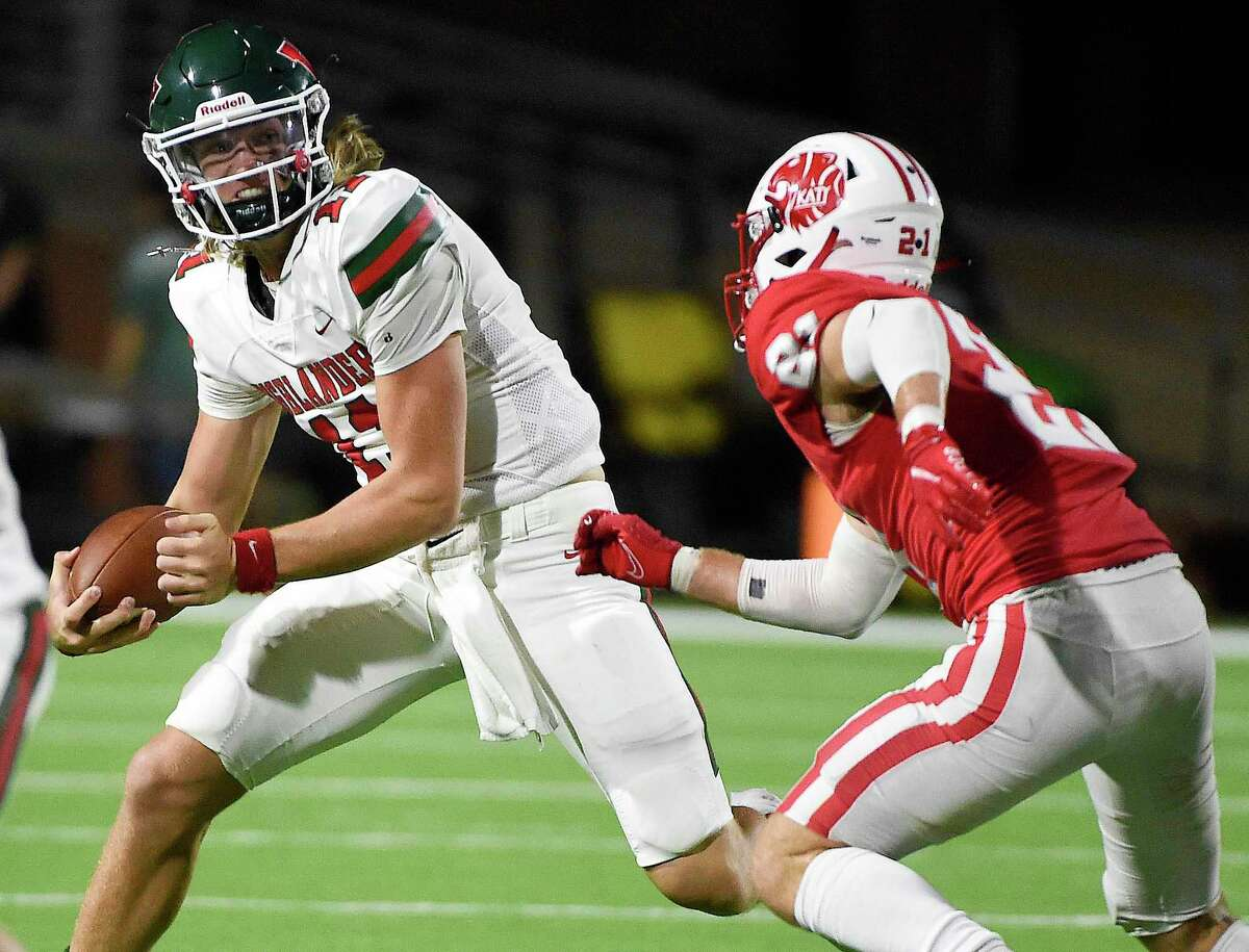 The Woodlands quarterback Mabrey Mettauer, left, tries to avoid the tackle of Katy linebacker Carson Marshall during the first half of a high school football game, Thursday, Sept. 16, 2021, in Katy.