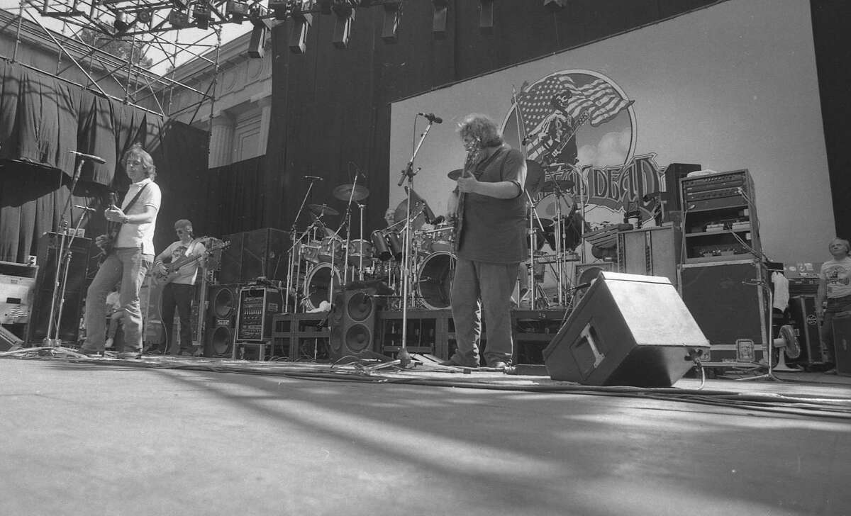 Grateful Dead show 20th anniversary at the Greek Theater September June 16, 1985. The poster behind the band is available in an auction from October 7-14.