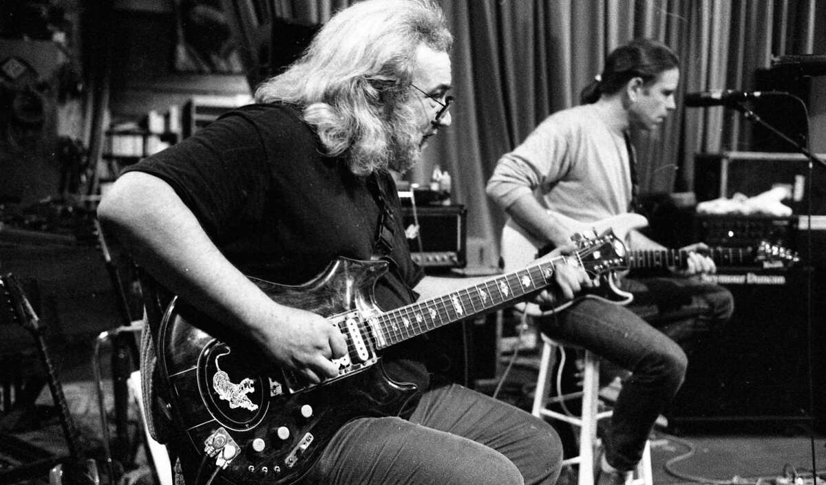 Grateful Dead members (L to r) Jerry Garcia and Bob Weir rehearse, with John Fogerty May 25, 1989 as San Francisco musicians would play a series of concert to benefit AIDS.