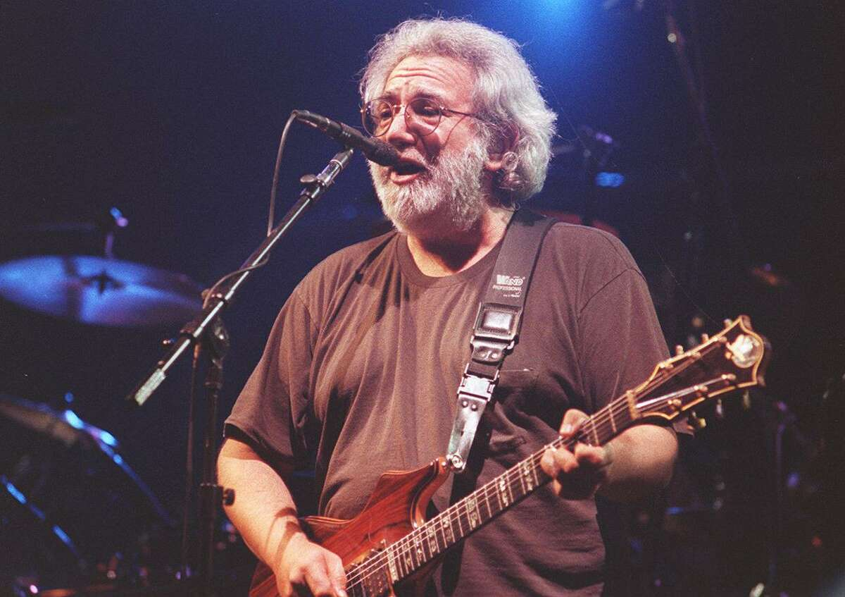 Jerry Garcia plays at a Grateful Dead concert at the Oakland Coliseum on Dec. 12, 1992. Garcia was one of six inductees to the California Hall of Fame on Tuesday.