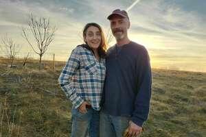 Beth Hoffman and John Hogeland on their farm in Iowa.