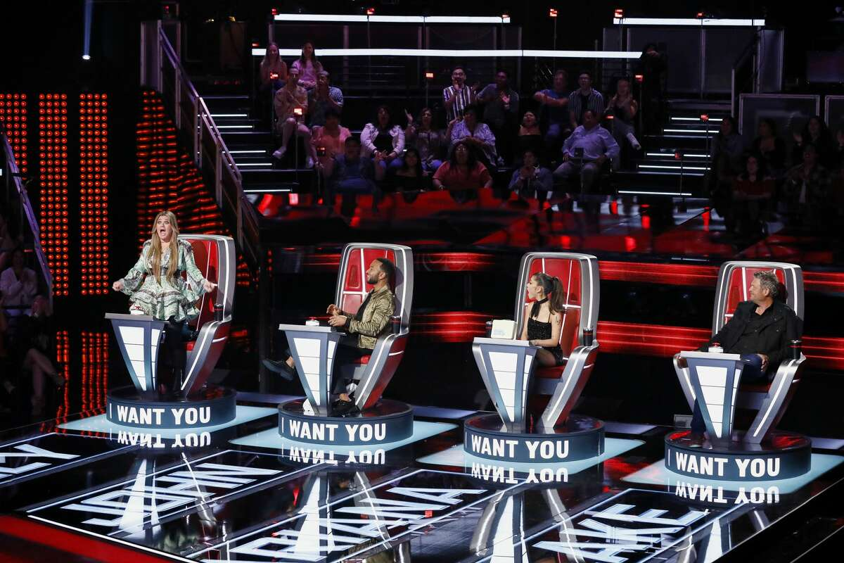 """Kelly Clarkson reacts after Aaron Hines of San Antonio chooses to join her team on """"The Voice"""" during Tuesday night's episode."""