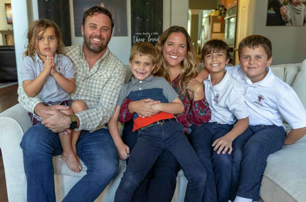 Jonathan and Shannon Badger pose with their children, from left, Sarah, 4; Christian, 7; Judah, 9; and Ethan, 8.