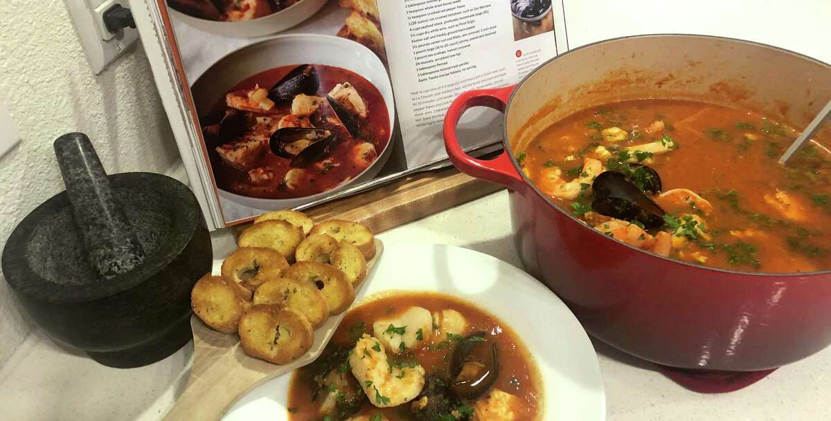 Ina Garten's cioppino as prepared by Todd Slack in one of his many enameled Dutch ovens. The colorful cast-iron pots are perfect for fall cooking.