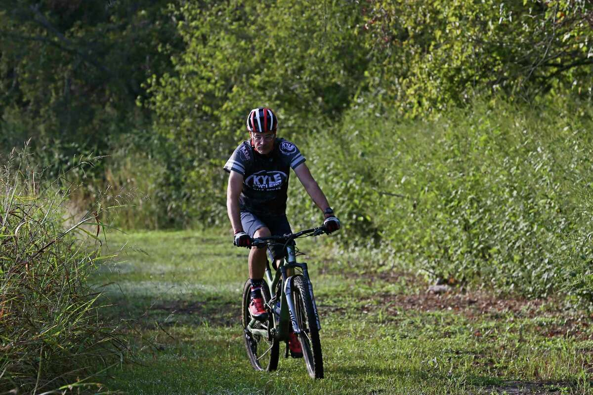 Cyclist James Stanfill, owner of Kyle Cyclery, rides the Plum Creek Park trail Monday in Kyle.