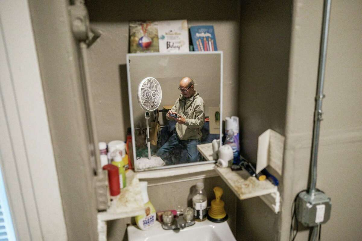 Jack Huck, 72, uses an Android phone, but has no internet access from his longtime room in the Winton Hotel, a single-room-occupancy residence in San Francisco. The Wi-Fi gap leaves many people isolated.