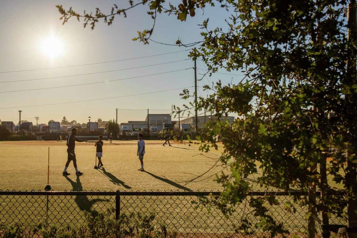 Yohannes Harish (left) trains young athletes at Estuary Park in Alameda. Harish is a professional soccer player with the Oakland Roots. He also trains athletes with the Golden Boot Academy at the park.