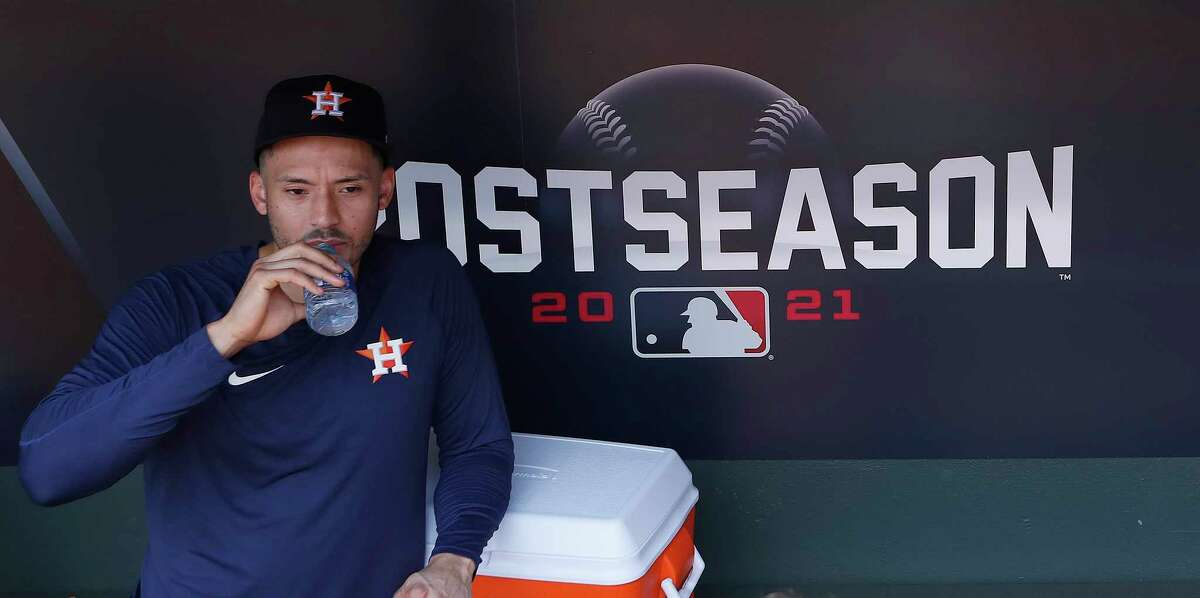 Houston Astros shortstop Carlos Correa in the dugout during batting practice ahead of Game 1 of the American League Division Series playoffs at Minute Maid Park, Wednesday, Oct. 6, 2021, in Houston.