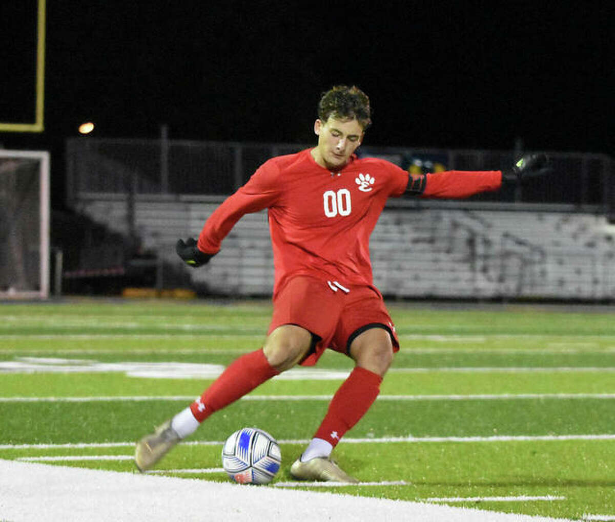 Edwardsville keeper Nathan Beck blasts a free-kick down the field during the second half on Tuesday in O'Fallon.