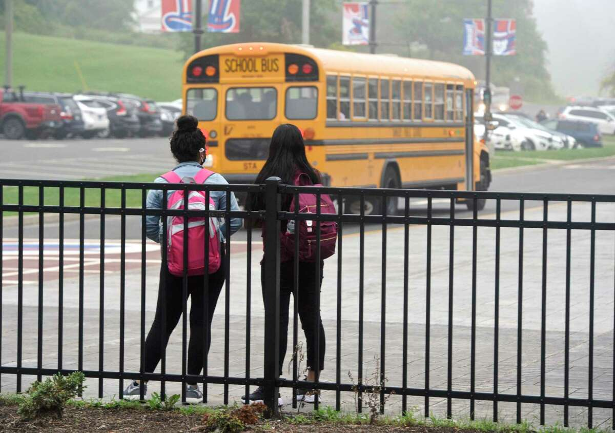 Students wait for the first day of the new school year at Danbury High School to begin. Monday, August 30, 2021, Danbury, Conn.