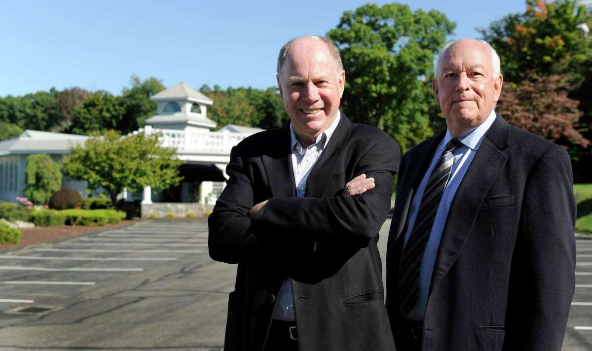 Fairfield Catering Group partners John Royce, left, and Tom Montague, outside The Candlewood Inn in 2014. Fairfield Catering Group's Fox Hill Inn is up for sale in the fall of 2021, with the company listing the property for $3.2 million.