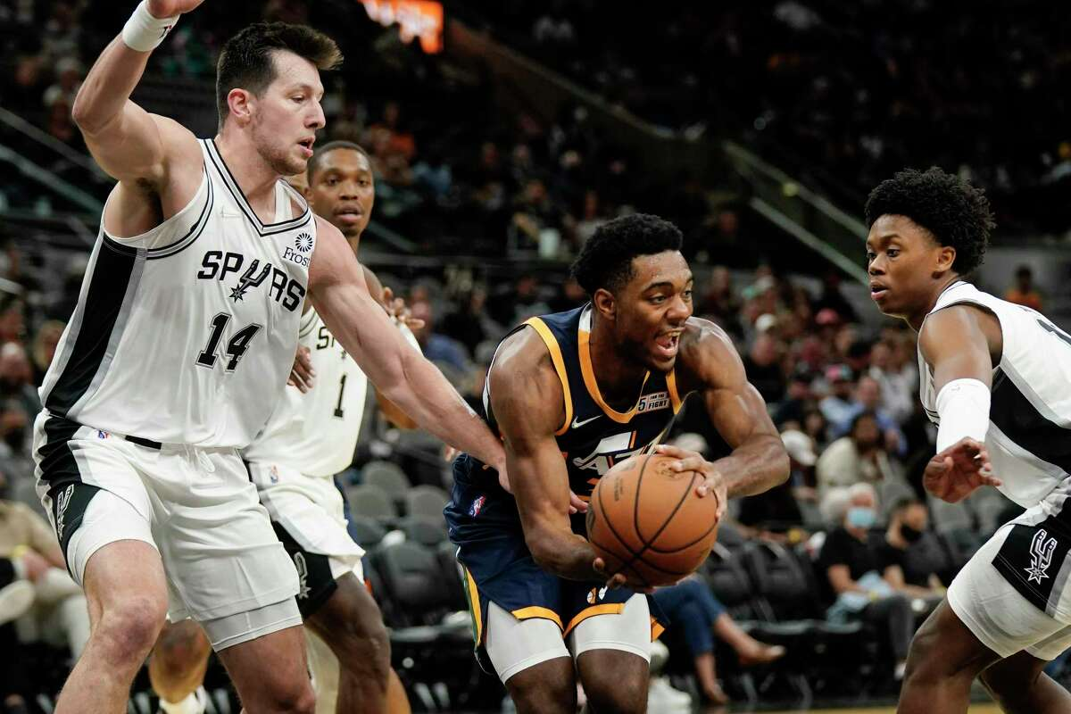 Utah Jazz's Trent Forrest, center, tangles with San Antonio Spurs' Josh Primo, right, Drew Eubanks (14) and Lonnie Walker IV during the second half of a preseason NBA basketball game on Monday, Oct. 4, 2021, in San Antonio.