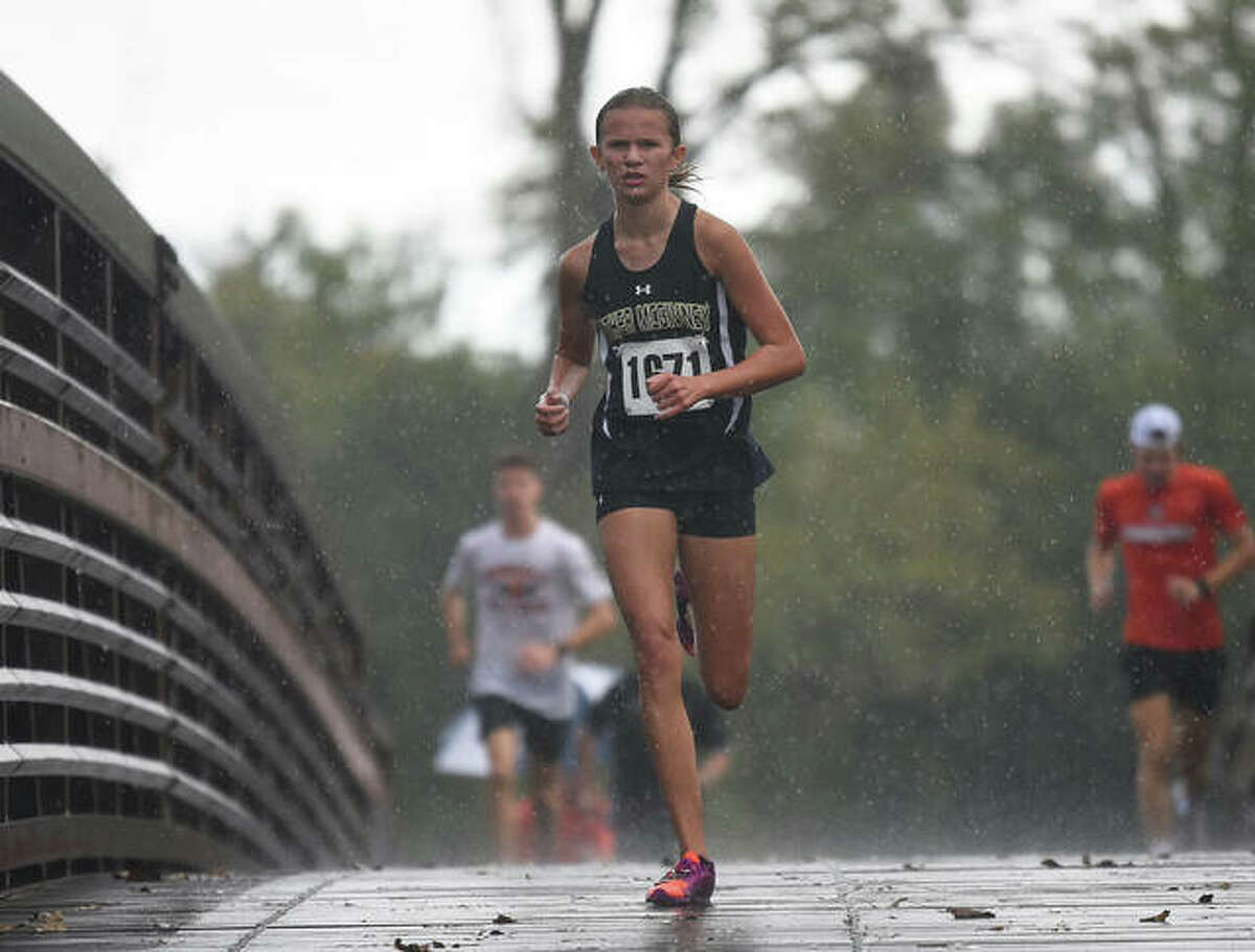 Father McGivney's Elena Rybak crosses over a bridge at the Bethalto Sports Complex during the Madison County Meet.