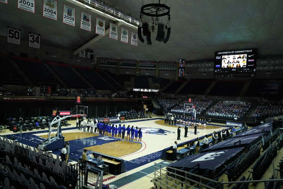 """Feb 10, 2021; Storrs, Connecticut, USA; The UConn Huskies and Seton Hall Pirates stand for the singing of """"Lift Every Voice and Sing"""" before the start of the game at Harry A. Gampel Pavilion. Mandatory Credit: David Butler II-USA TODAY Sports"""