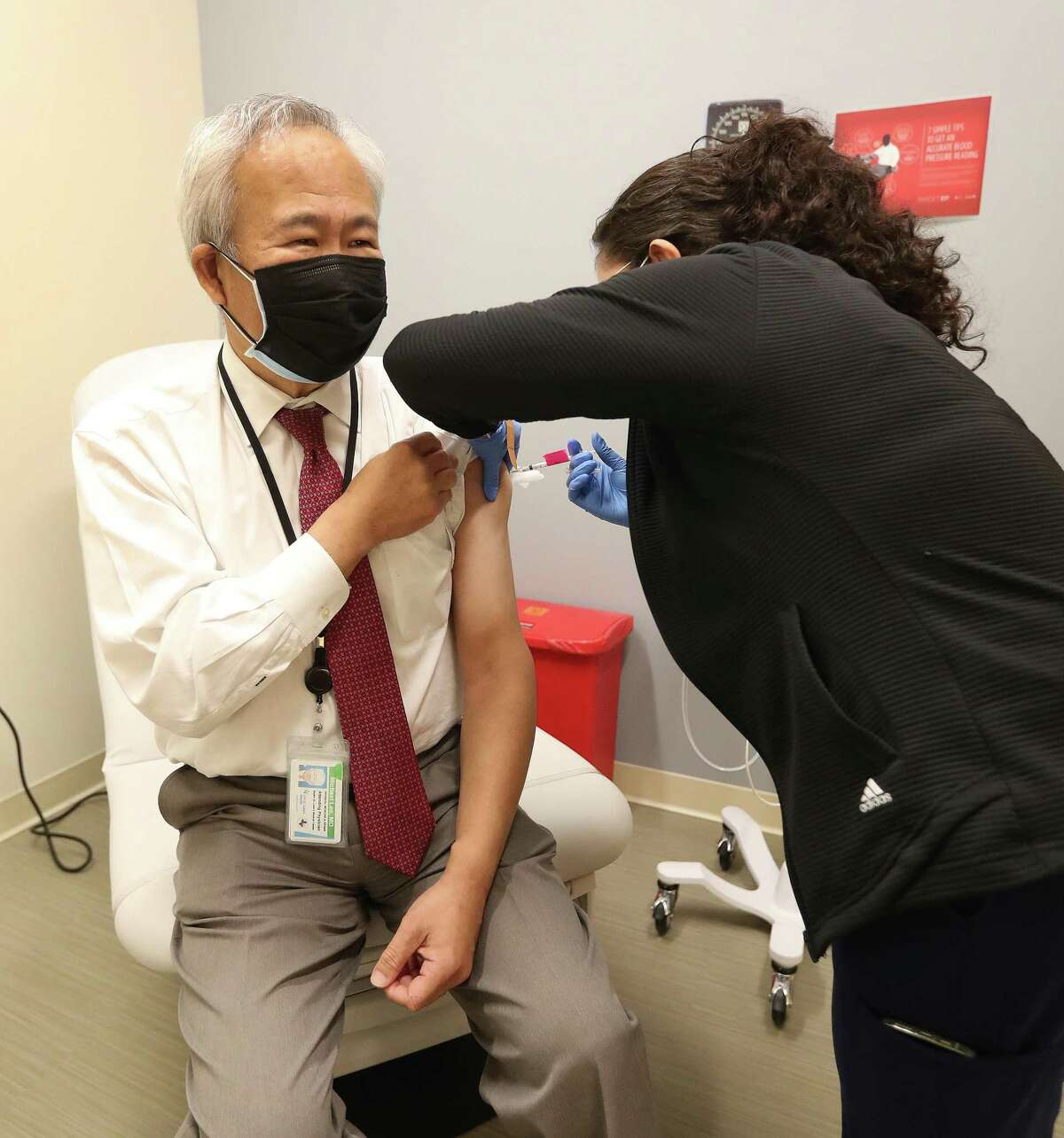 Kimberly Acosta, CMA, gives Dr. Michael Lee, Professor and Chair, H. Ben Taub Department of Physical Medicine and Rehabilitation, Baylor College of Medicine, his third dose of the Pfizer vaccine, as a booster, at Baylor College of Medicine, Friday, September 24, 2021, in Houston, after the CDC gave boosters the go ahead last night.