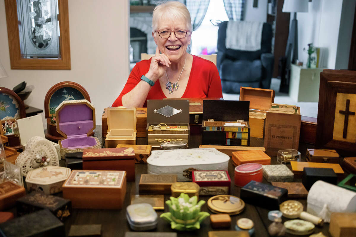 Cindy Warrick poses for a portrait with her collection of small boxes Tuesday, Oct. 5, 2021 at her home in Sanford. (Katy Kildee/kkildee@mdn.net)
