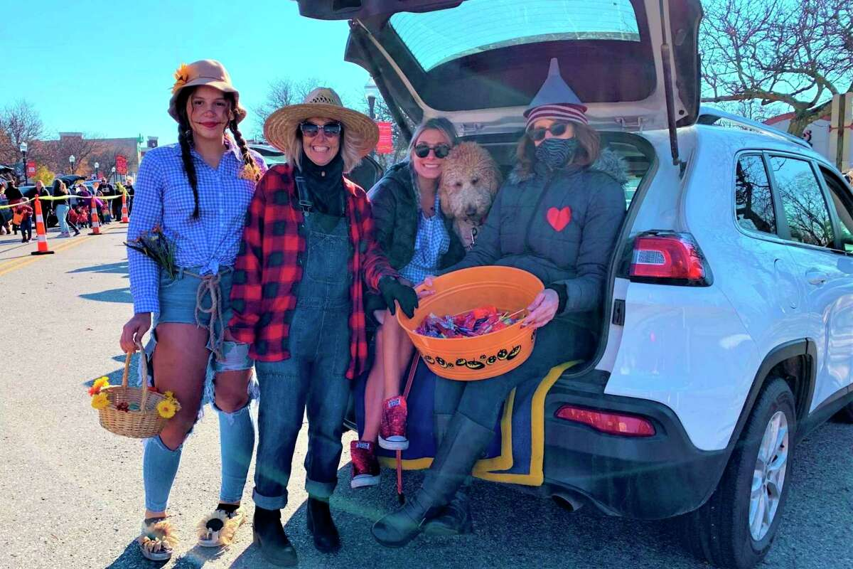 In this Oct. 31, 2020, Pioneer file photo, Trunk or Treat participatestake a break from passing out candy to flash a few smiles to the camera. This year's Trunk or Treat is scheduled to run from noon to 2 p.m. Saturday, Oct. 30. (Pioneer file photo)