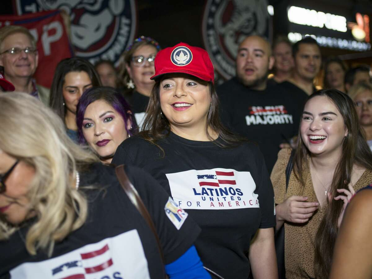 SAN ANTONIO, TX - MAY 14: Jen Salinas, Vice President of Latinos 4 Trump, takes photos with the groups supporters after a meetup in San Antonio, Tx., U.S. on Friday, May 14, 2021. Latinos 4 Trump invited local candidates to speak with their supporters during the event held at The Angry Elephant bar in San Antonio. (Photo by Matthew Busch for The Washington Post via Getty Images)
