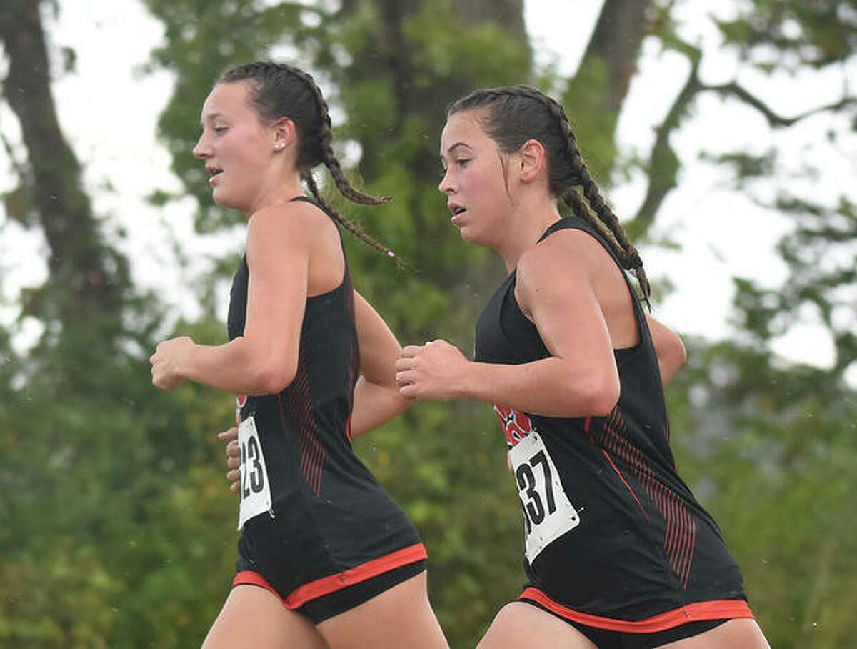 Edwardsville's Olivia Coll, right, and Emily Nuttall complete the second mile of the Madison County Meet on Tuesday in Bethalto.