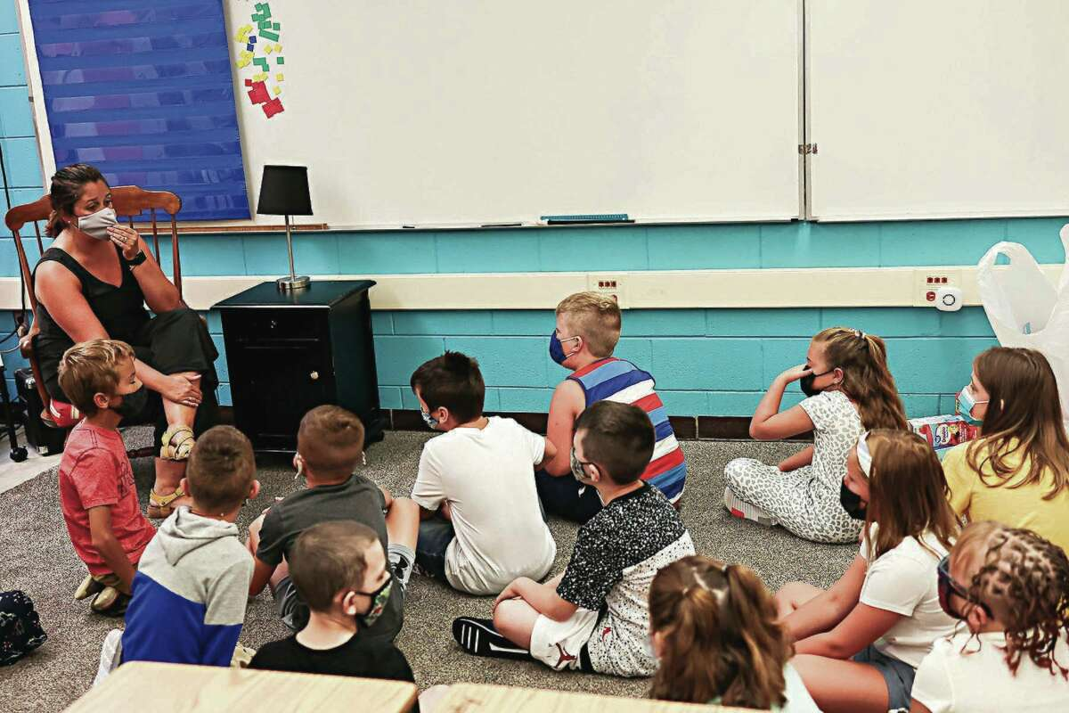 Jennifer Abel, third grade teacher, talks to students on the first day of school at Kennedy Elementary on Aug. 31. Wednesday was count day in Michigan, in which student attendance is tied to funding public schools receive from the state.