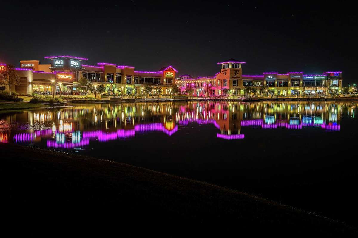 The Boardwalk at Towne Lake in northwest Houston is awash in pink with lights recognizing Breast Cancer Awareness month this October.
