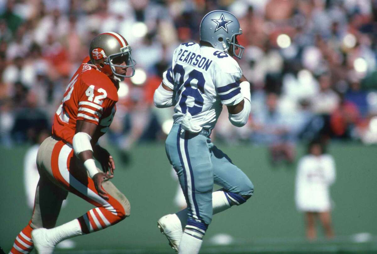 SAN FRANCISCO, CA - OCTOBER 11: Wide Receiver Drew Pearson #88 of the Dallas Cowboys runs with the ball, pursued by Ronnie Lott #42 of the San Francisco 49ers during an NFL football October 11, 1981 at Candlestick Park in San Francisco, California. Pearson played for the Cowboys from 1973-83. (Photo by Focus on Sport/Getty Images)