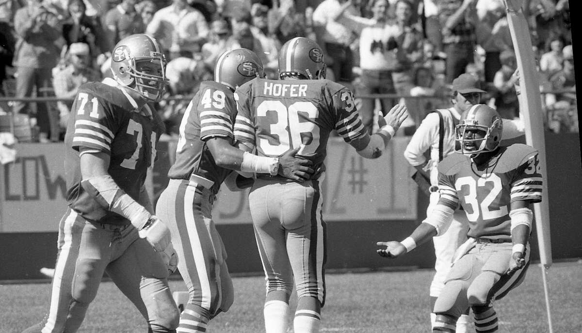 San Francisco 49ers running back Paul Hofer celebrates with teammates after scoring versus the Dallas Cowboys in 1981.