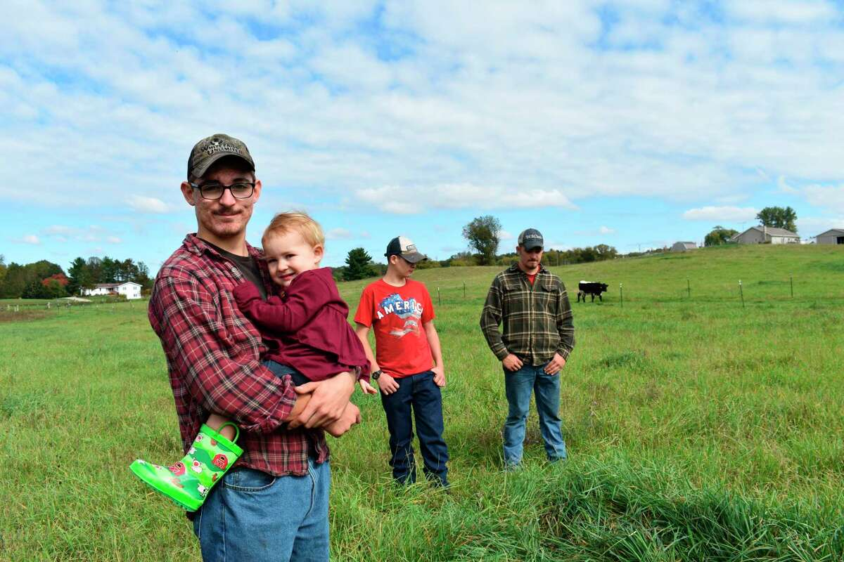 Brothers Sawyer, Scott and Jarrad Stilson help with work on their family farm which often includes upkeep of the farm's cows and being good role models for their younger sister Ina May. (Pioneer photo/Olivia Fellows)