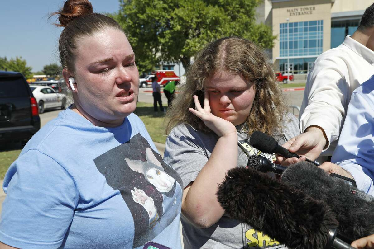MANSFIELD, TX - OCTOBER 06: Stephanie Wade and her daughter Keeley, 14, talk to reporters as they are reunited after a shooting at Timberview High School in Arlington, on October 6, 2021 in Mansfield, Texas. Students from the high school were reunited with parents inside the Mansfield ISD Center for the Performing Arts. According to reports, four people were injured in the shooting and a person of interest has been taken into custody. (Photo by Stewart F. House/Getty Images)
