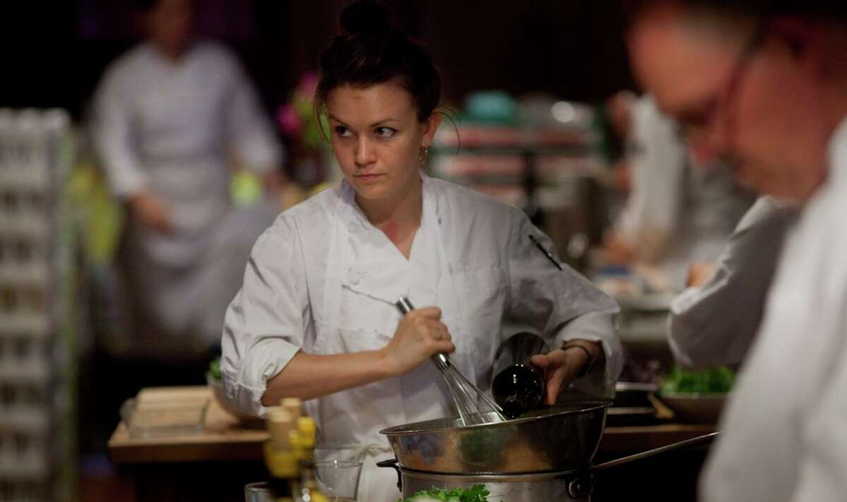 Sylvie Osborne-Calierno, then a line cook, mixes ingredients for the first course of a meal at Chez Panisse in 2011.