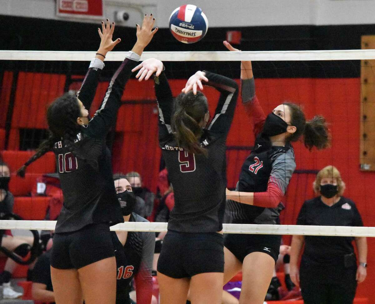 Cheshire's Avery Mola spikes the ball in SCC Division B girls volleyball championship game at Cheshire High School on Friday, Oct. 13, 2020.