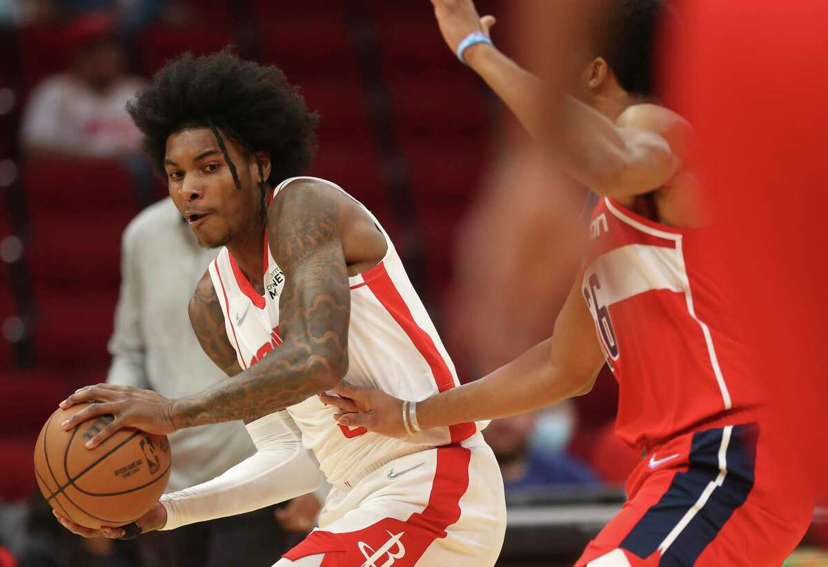 Kevin Porter Jr. looked to direct the Rockets' offense rather than shoot first in preseason opener against Washington.