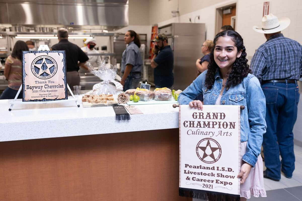 Turner College and Career High School's Sofia Restrepo holds the Culinary Grand Champion award she received during the 10th annual Pearland Independent School District Livestock Show & Career Expo.