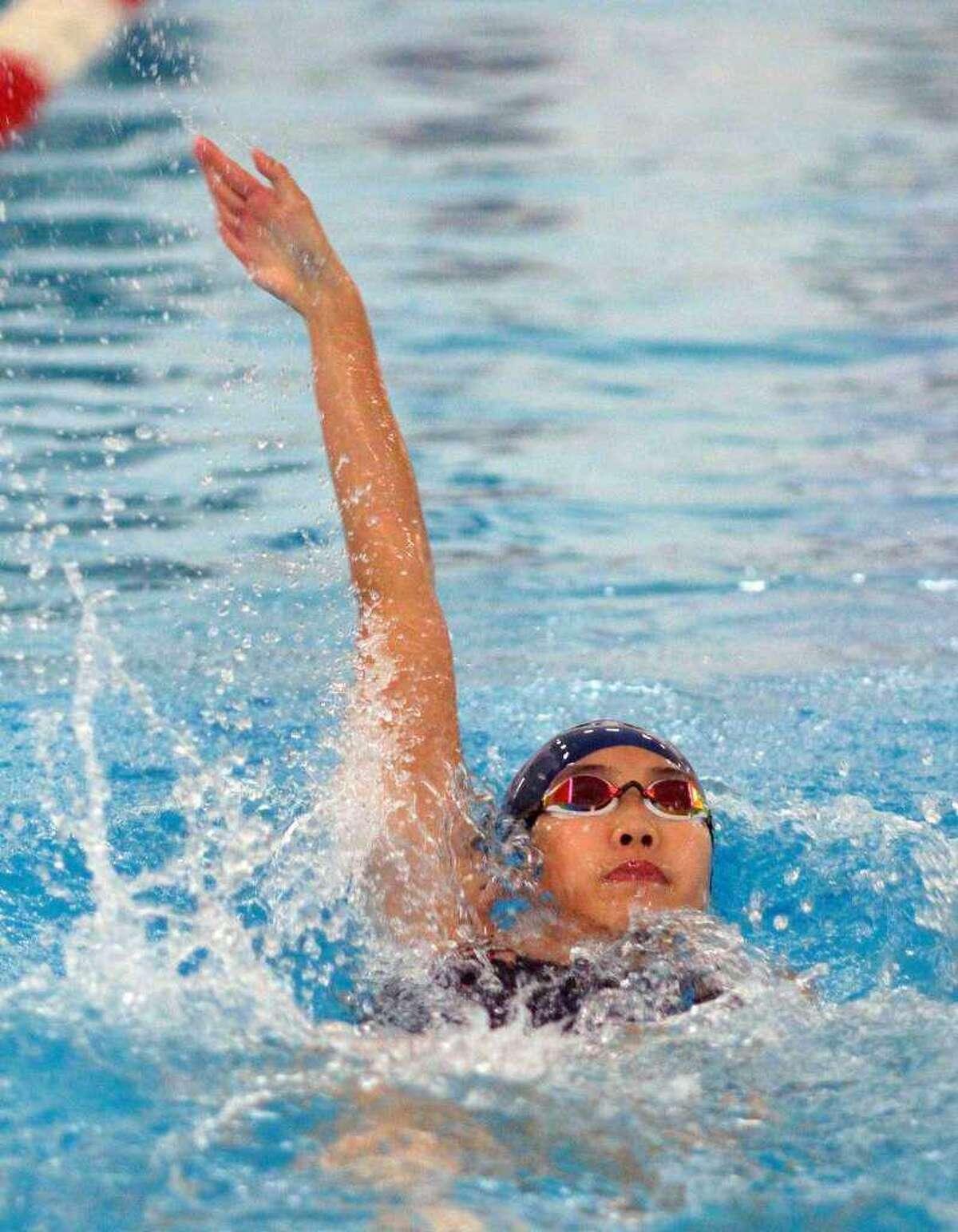 Foran High's Ellen Pan competes in the 100-meter backstroke.
