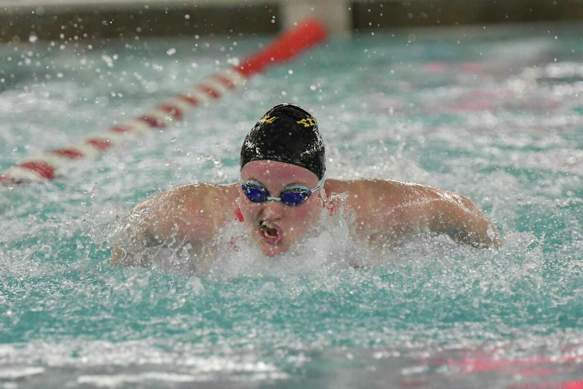 Lauren Walsh of the Trumbull Eagles swims the butterfly leg of the 200-yard medley relay during the FCIAC Girls Swimming Championship on Nov. 5, 2019 at Greenwich High School in Greenwich.