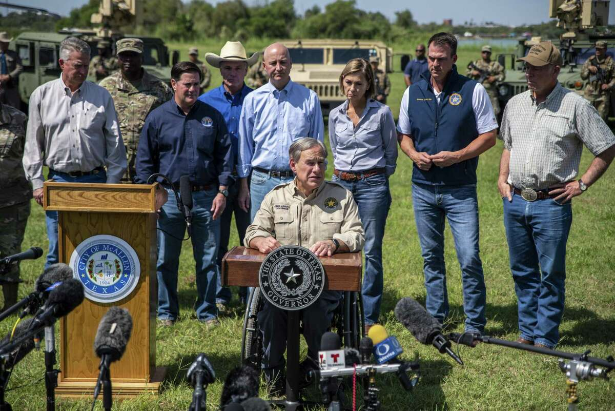 Greg Abbott, governor of Texas, speaks during a news conference in Mission, Texas, U.S., on Wednesday, Oct. 6, 2021. Abbott and Republican state chief executives from around the nation gathered at the border to again call attention to unauthorized immigration across the Rio Grande. Photographer: Sergio Flores/Bloomberg