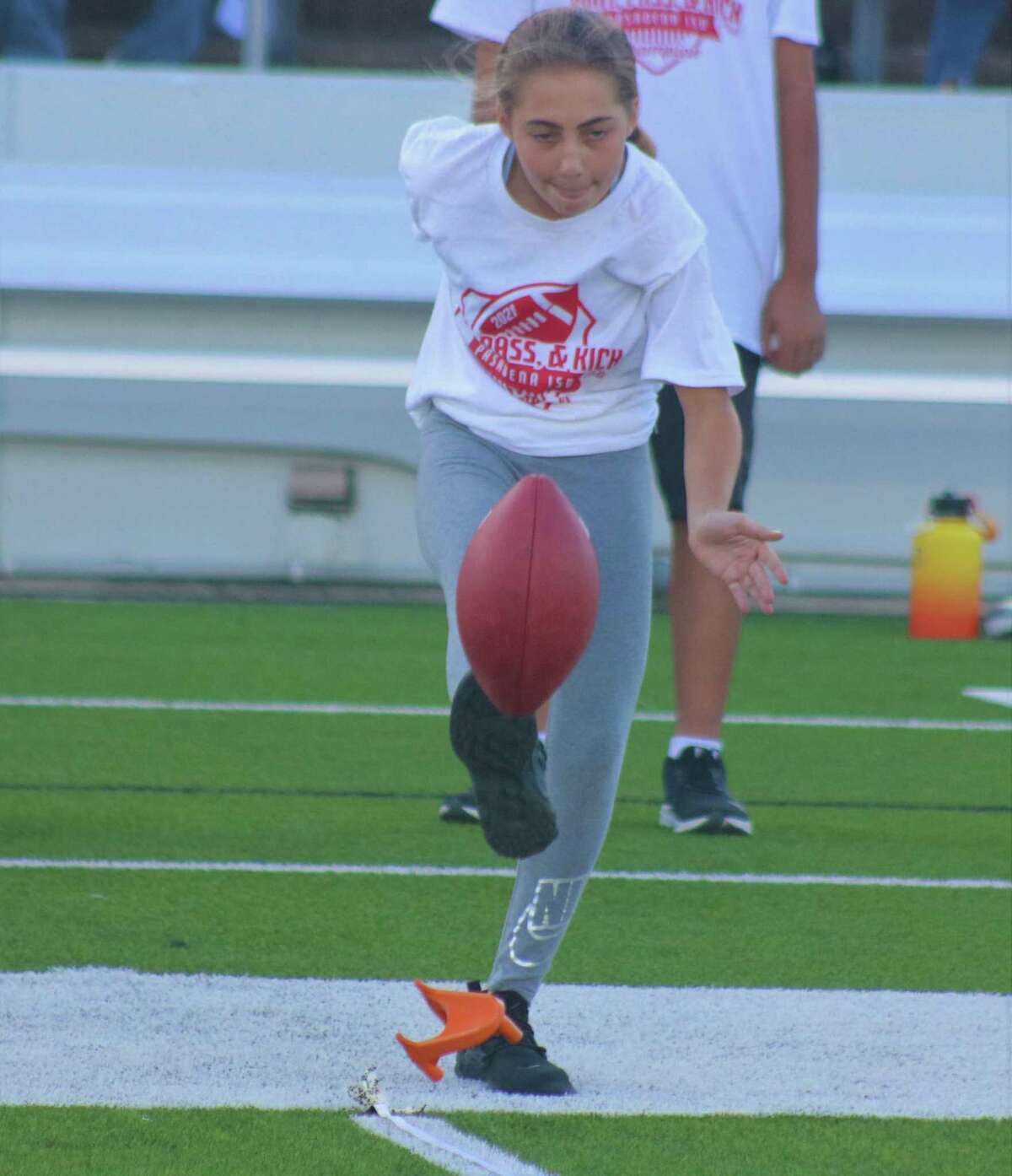 Morris Middle School's Destiny Sidiropoulos attempts her punt try during the school district's Punt, Pass & Kick competition at Veterans Memorial Stadium Monday.