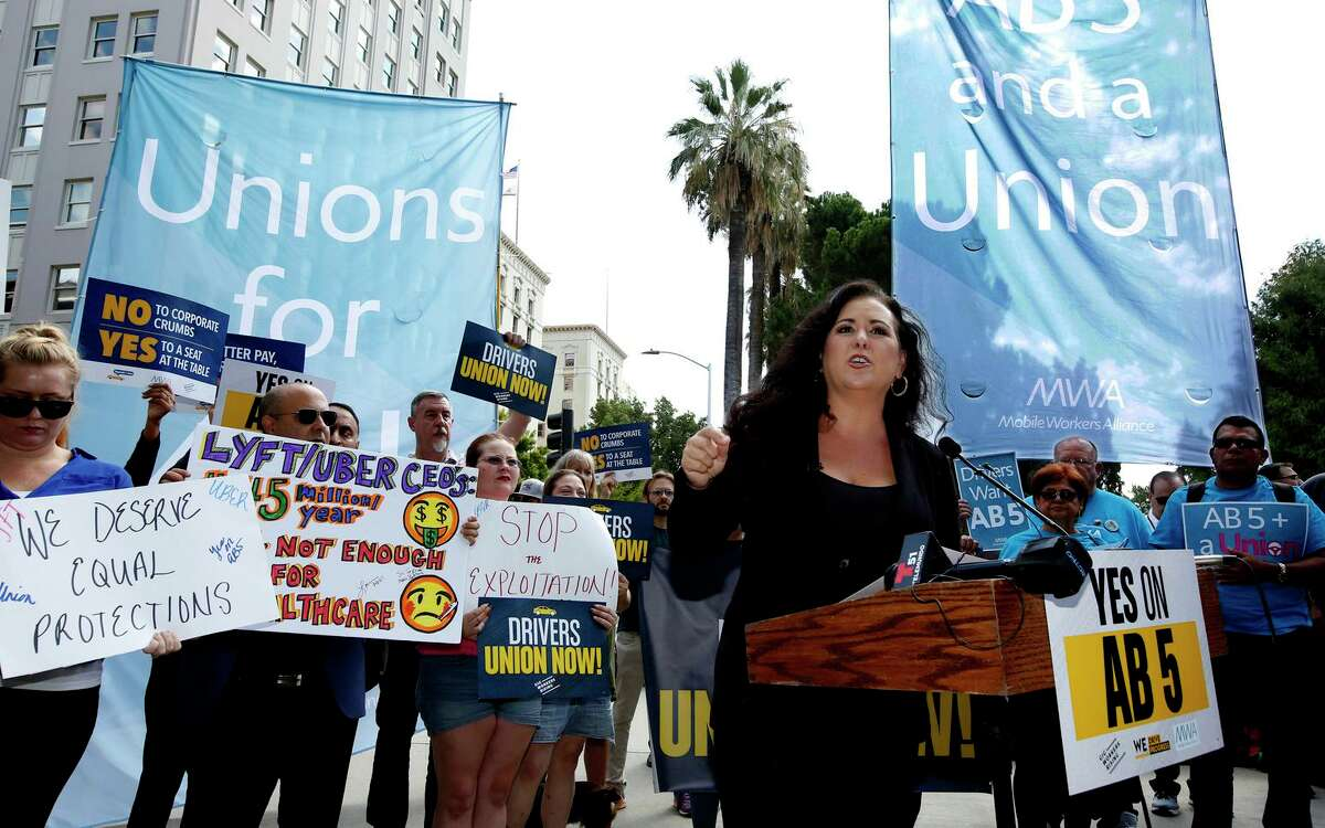 Assembly Member Lorena Gonzalez, D-San Diego, speaks at a 2019 rally calling for passage of AB5, a law limiting when employers can classify workers as independent contractors. The law survived a challenge before the Ninth U.S. Circuit of Appeals in San Francisco on Wednesday.