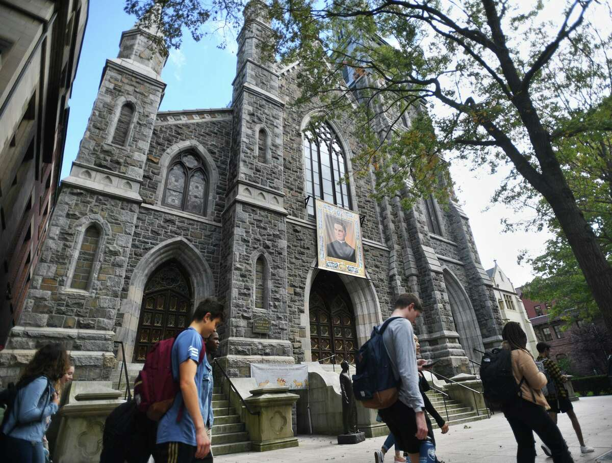 Students walk past St. Mary Roman Catholic Church on Hillhouse Avenue in New Haven Wednesday.