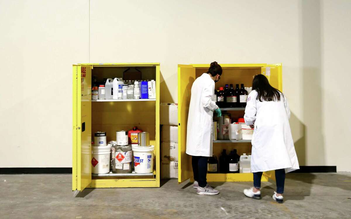 Employees at Solugen work in the facility in Houston on Wednesday, Oct. 6, 2021.