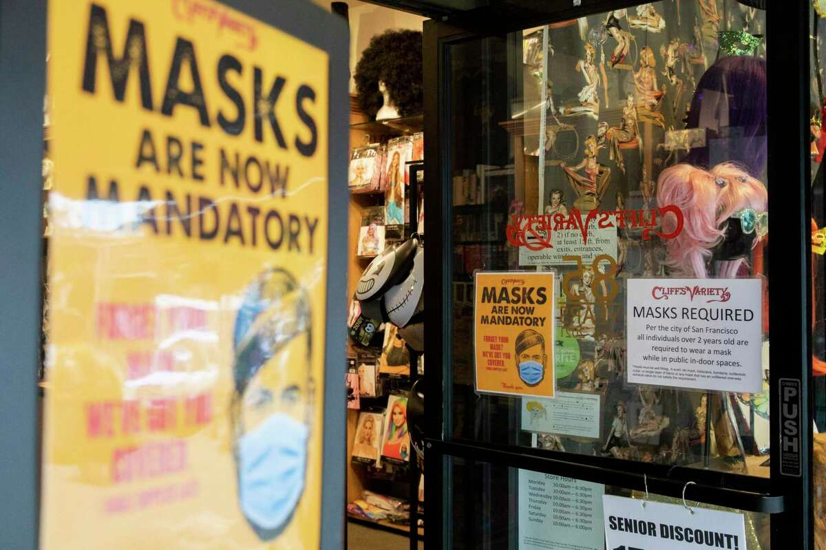 Signage reminds customers to wear masks while inside Cliff's Variety on Castro Street in San Francisco, Calif.