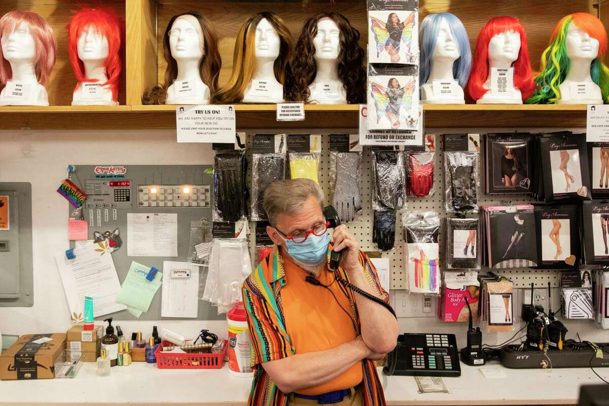Cliff's Variety manager Paul Ellis wears a mask while talking on the phone to a customer inside Cliff's Variety on Castro Street in San Francisco, Calif. Wednesday, October 6, 2021.