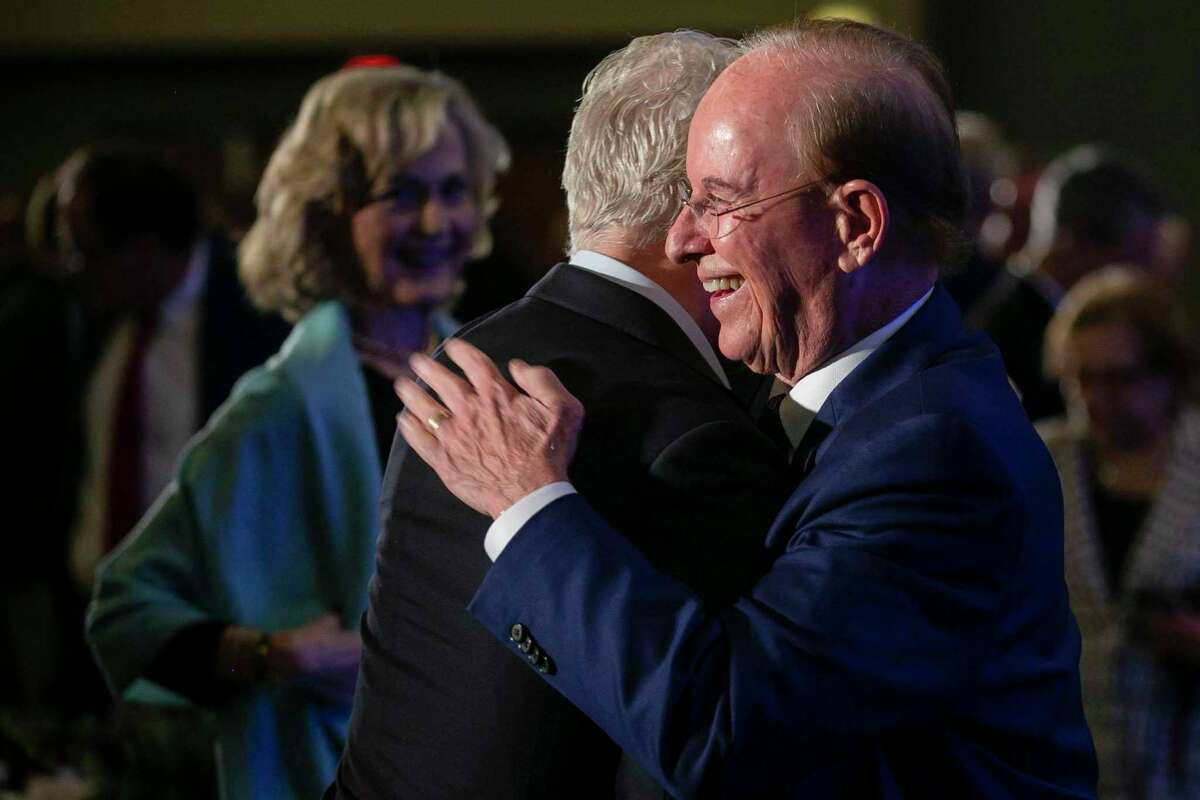 Bexar County Judge Nelson Wolff embraces a friend after delivering his second-to-last State of the County address at downtown's Grand Hyatt Texas Ballroom on Wednesday.