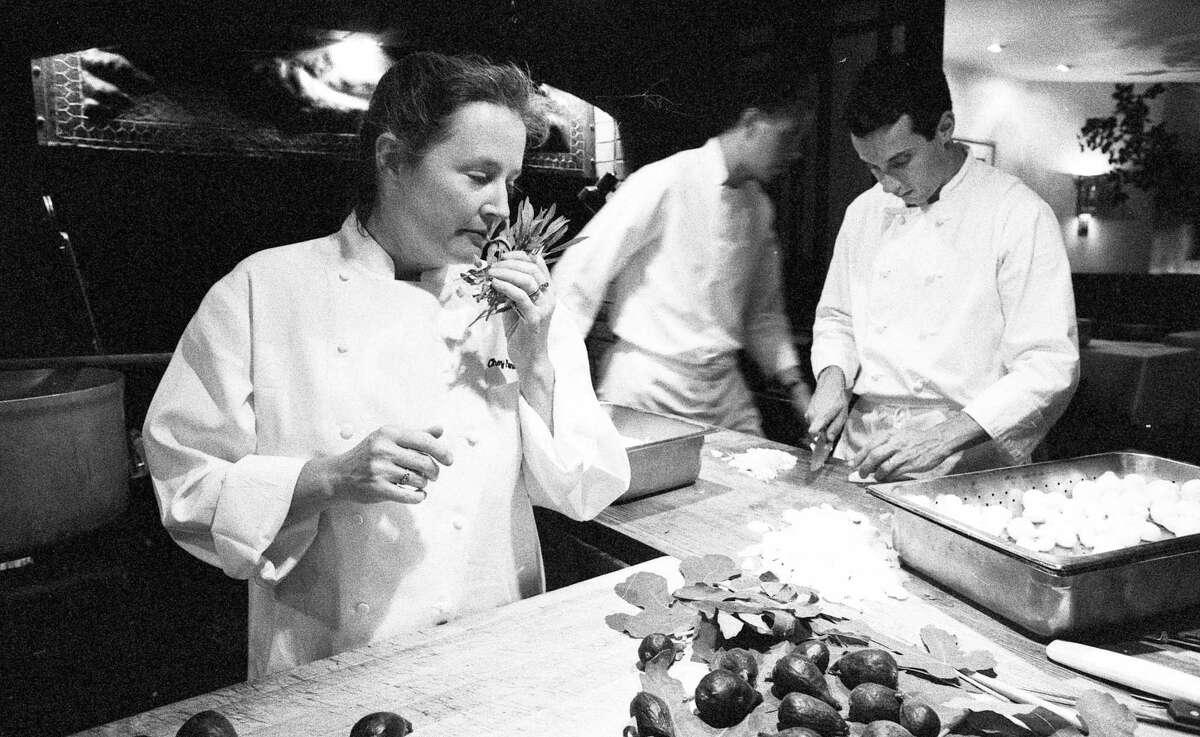 July 11, 1990: Alice Waters prepares dinner at Chez Panisse restaurant in Berkeley.