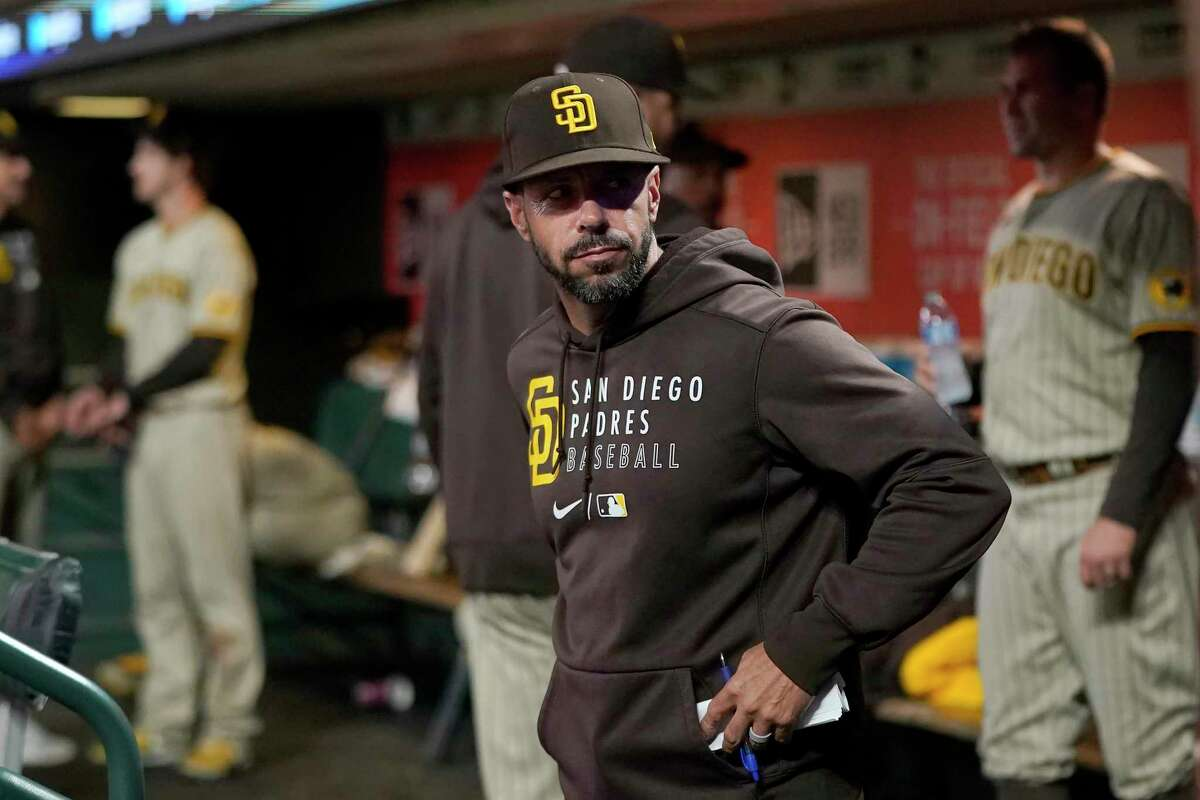 San Diego Padres manager Jayce Tingler stands in the dugout during the eighth inning of his team's baseball game against the San Francisco Giants in San Francisco, Friday, Oct. 1, 2021. (AP Photo/Jeff Chiu)