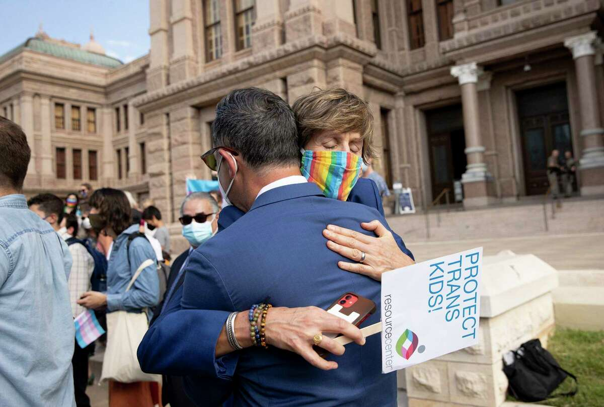 Cece Cox, CEO of Resource Center in Dallas, hugs State Rep. Rafael Anchia, D - Dallas, after he spoke at a rally against House Bill 25, a bill that would ban transgender girls from participating in girls school sports, at the Capitol on Wednesday October 6, 2021.