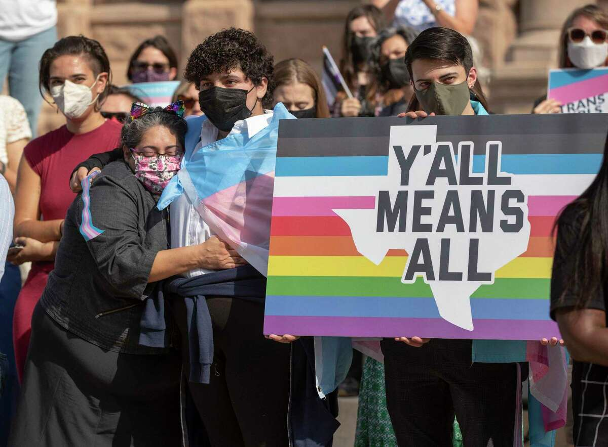 Claudia Carranza, of Harlingen, hugs her son, Laur Kaufman, 13, at a rally against House Bill 25, a bill that would ban transgender girls from participating in girls school sports, at the Capitol on Wednesday October 6, 2021.