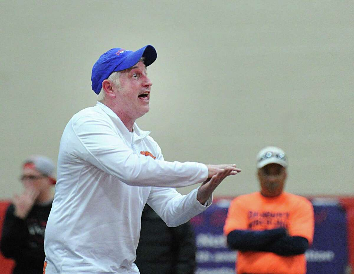 Danbury High School wrestling coach Ricky Shook reacts during the FCIAC Wrestling Championships at New Canaan High School, Conn., Saturday, Feb. 11, 2017.