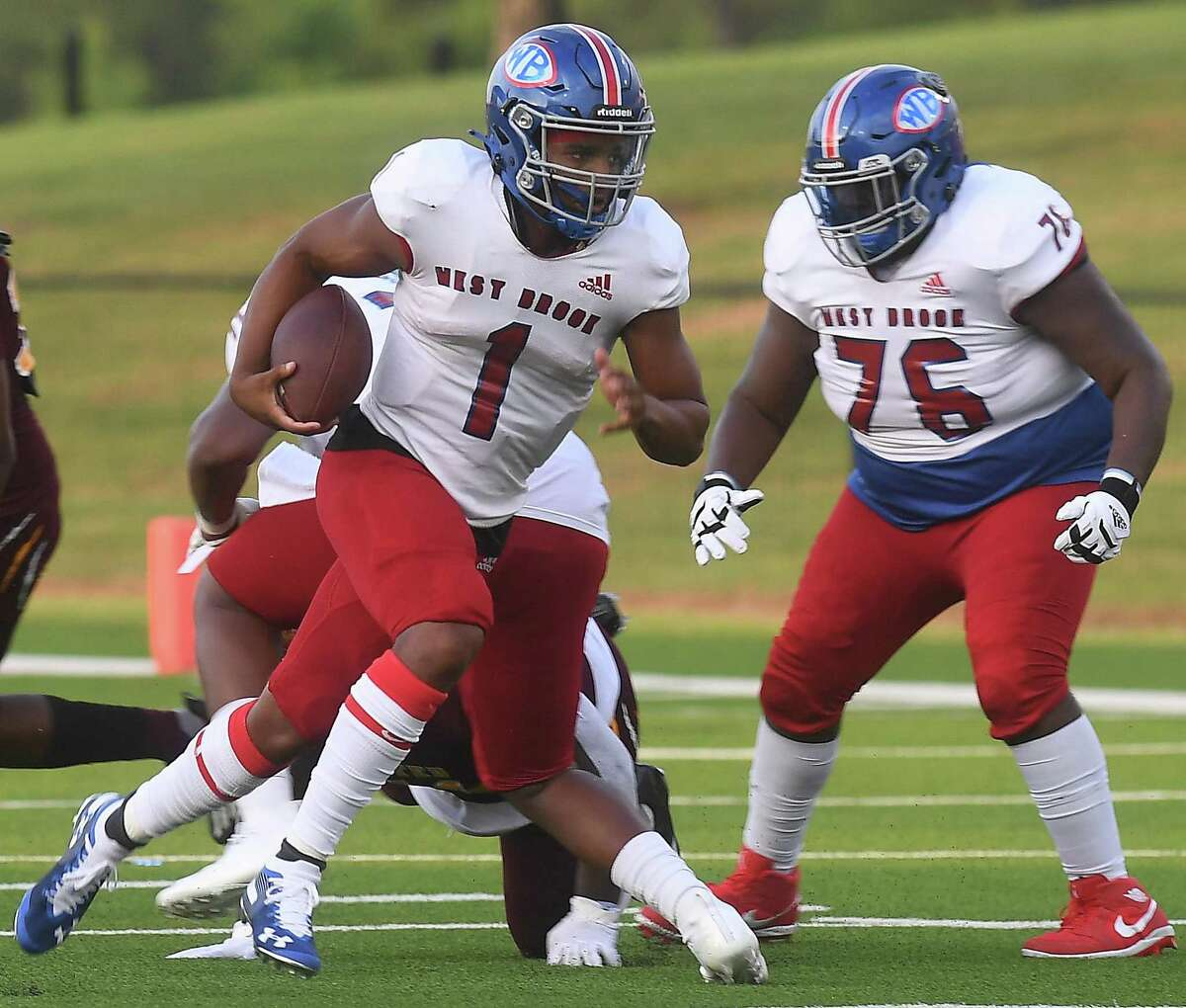 West Brook's Bryce Anderson runs the ball against Beaumont United during the season opening Alumni Bowl game Friday at BISD Memorial Stadium. Photo made Friday, August 27, 2021 Kim Brent/The Enterprise
